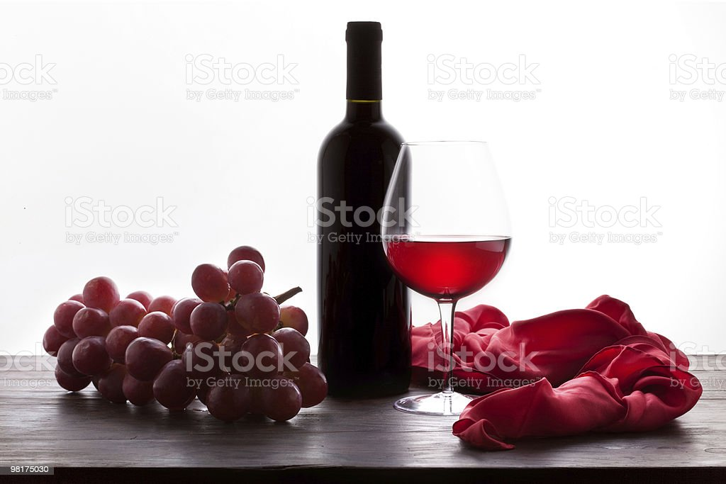 Glass of Red Wine and Bottle with Grapes royalty-free stock photo