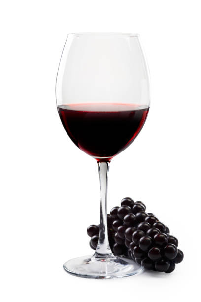 Glass of red wine and grapes on a white background. Isolated white background. stock photo