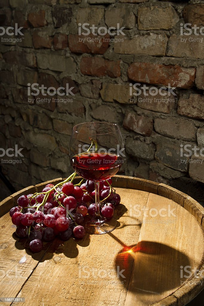 Glass of red wine and grapes royalty-free stock photo