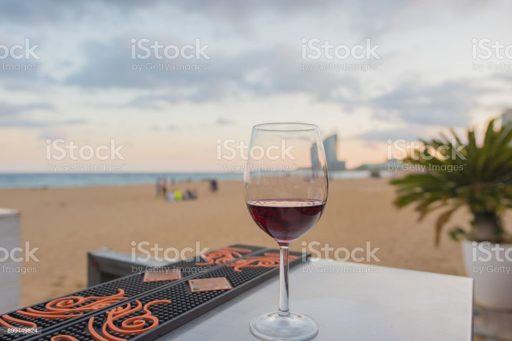 A glass of red wine at the beach in Barcelona stock photo