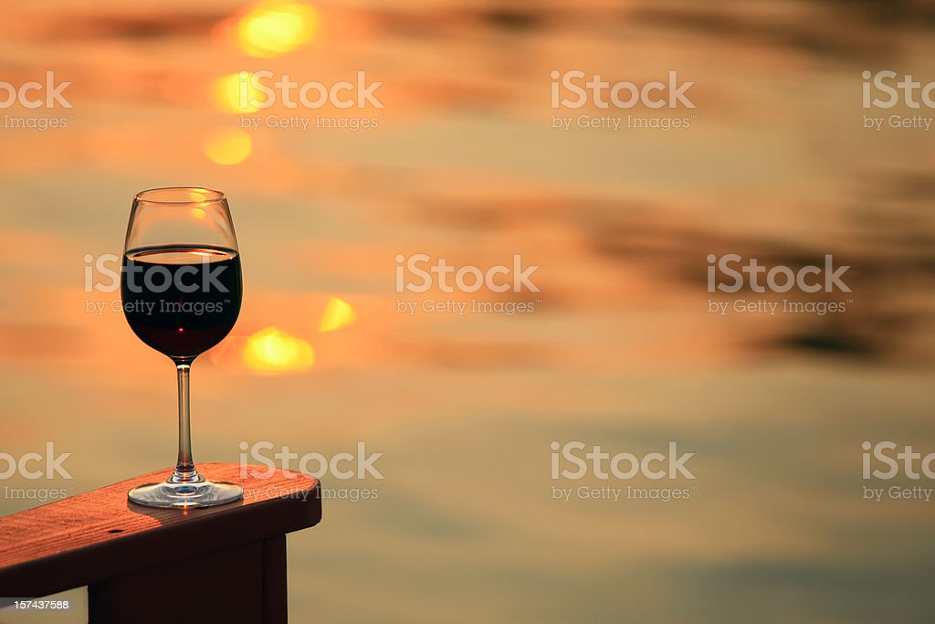 Glass of Red Wine by the Lake royalty-free stock photo