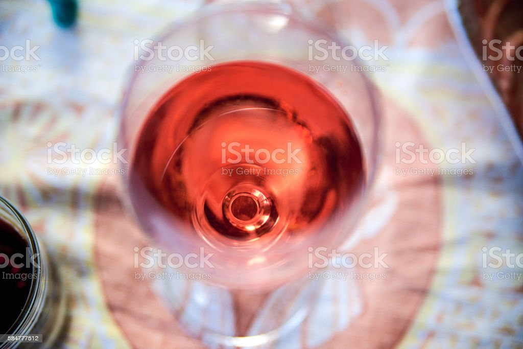 Glass of red wine closeup top view stock photo