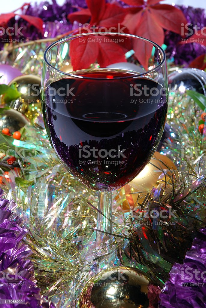 Glass of red wine on a Cristmas background royalty-free stock photo
