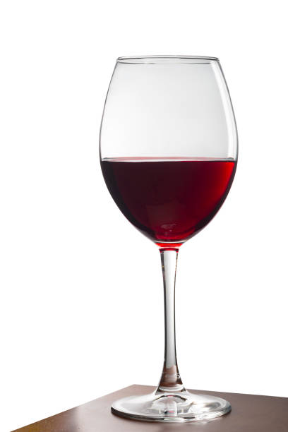 Glass of red wine on a wooden table. White background. Isolated white background. stock photo