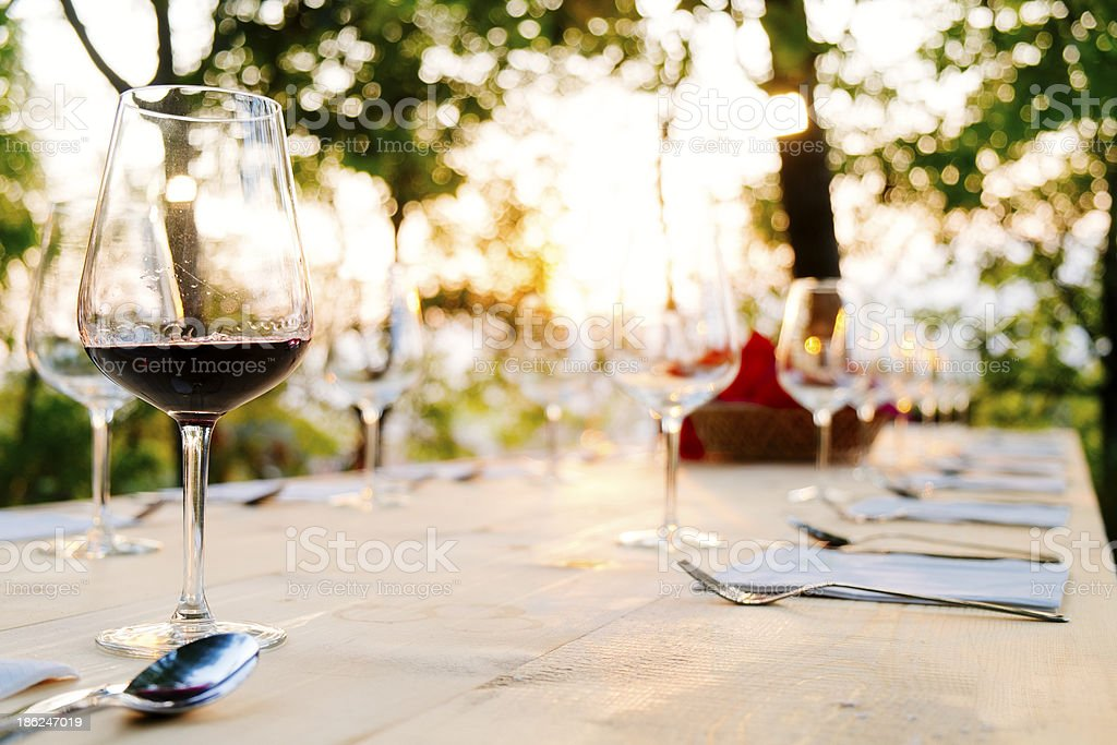 Glass of red wine on dinner tablet stock photo