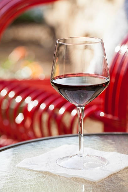 Glass of red wine on outdoor table stock photo