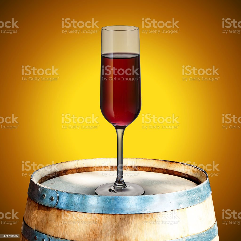 Glass of red wine on wood barrel royalty-free stock photo