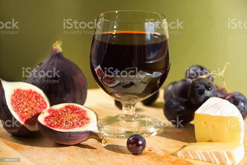 Glass of red wine with figs, grapes and cheese royalty-free stock photo