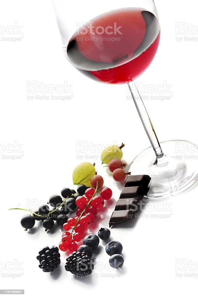 Glass of red wine with fruits and chocolate royalty-free stock photo