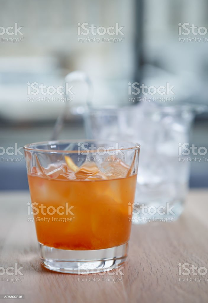 Glass of refreshing exotic alcohol long drink with ice stock photo
