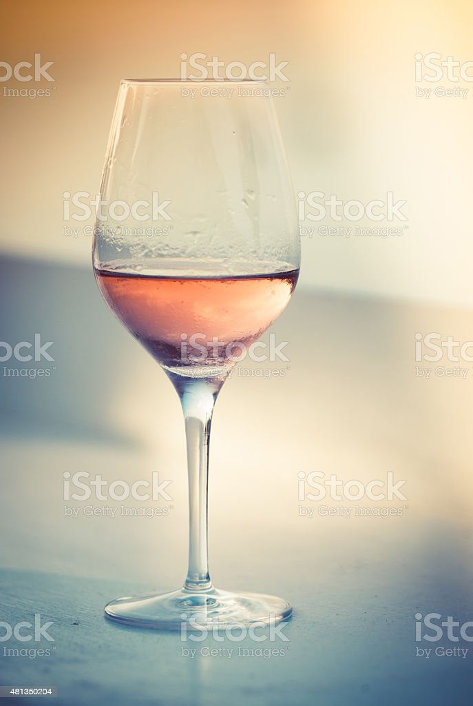 Glass of rosé wine stock photo