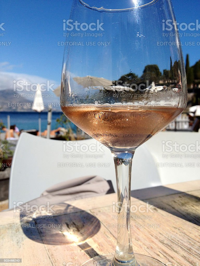 Glass of rose on the beach in france stock photo