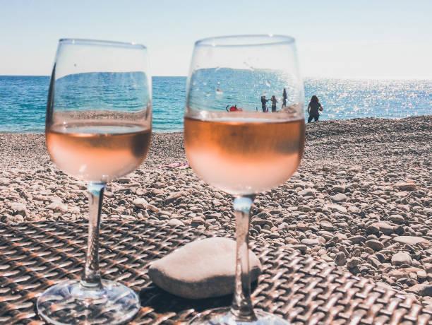 Glass of rose wine on a beach in french riviera picture id1081090938?b=1&k=6&m=1081090938&s=612x612&w=0&h=kudaqjds92w2jedv 5ejdbkbjggeimqrrlh89ruehpc=
