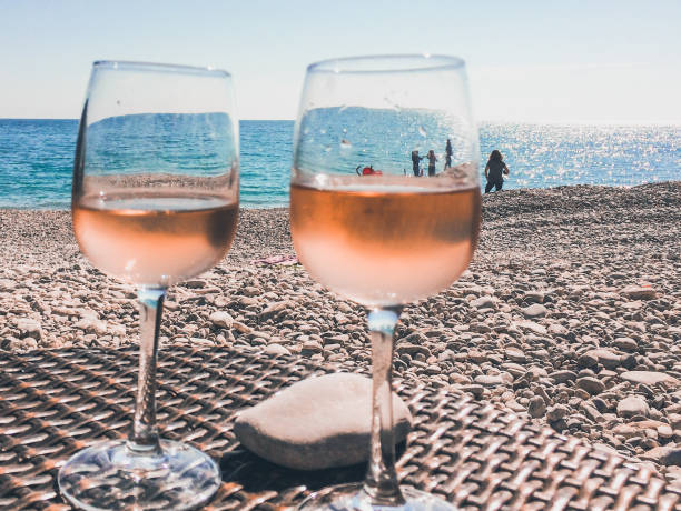 Glass of rose wine on a beach in French Riviera Cote d'Azur French Riviera is situated in the southern eastern part of the mediterranean coast of France and it is famous for its exclusive beaches and its beautiful sea sergionicr stock pictures, royalty-free photos & images