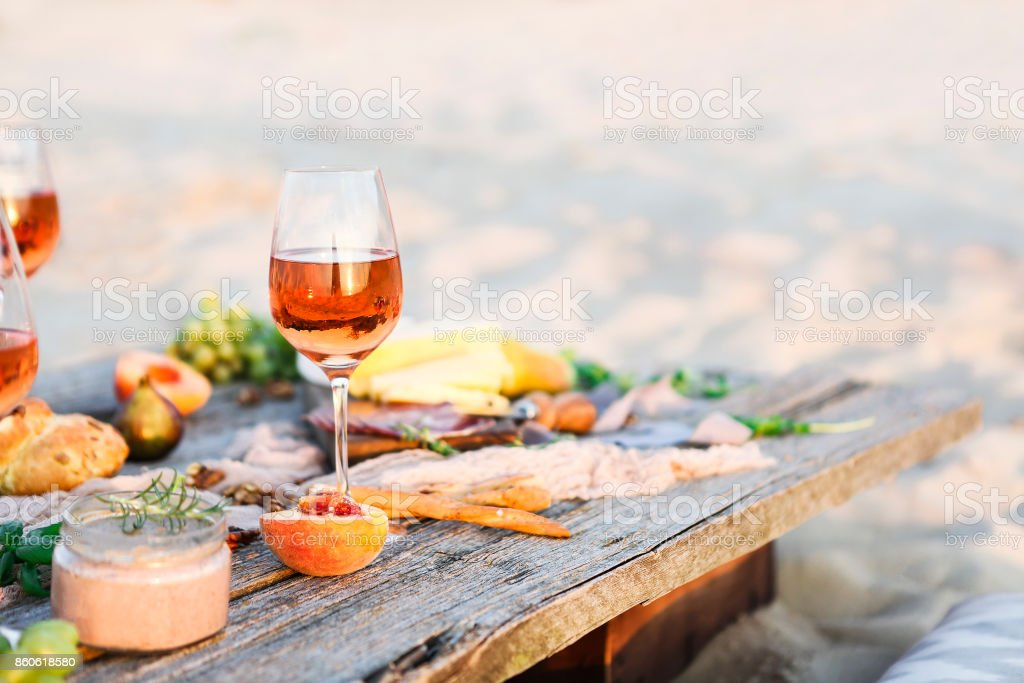 Glass of rose wine on rustic table stock photo