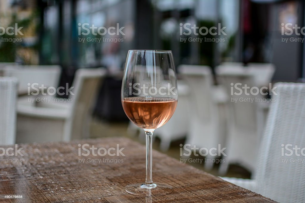 Glass of rose wine stock photo