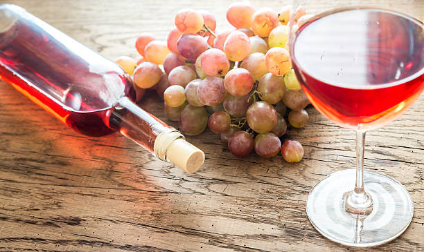 Glass of rose wine with bunch of grape picture id490517264?b=1&k=6&m=490517264&s=612x612&w=0&h=jlxhb8kp0yjmcty1bfbe3lkheejcjrfx2l4xtvxli u=