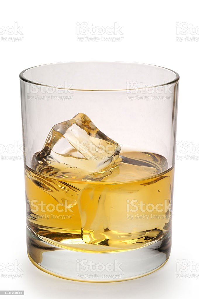 Glass of scotch and ice vertical with clipping path royalty-free stock photo
