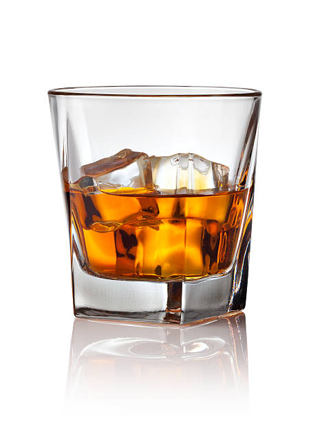 glass of scotch whiskey and ice - whiskey stock photos and pictures