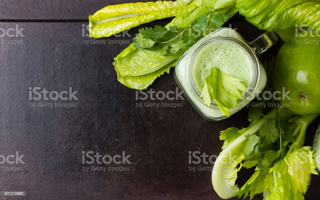 Glass of smoothie, fresh green vegetables and fruits.  Top view stock photo