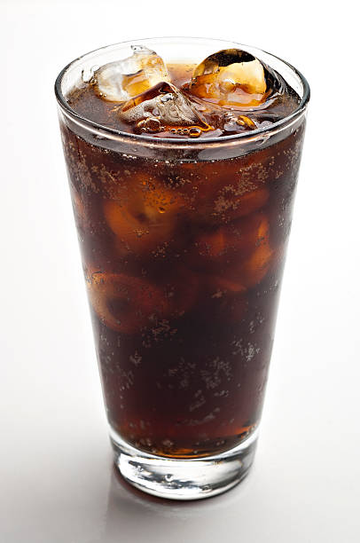 glass of soda with ice cubes stock photo