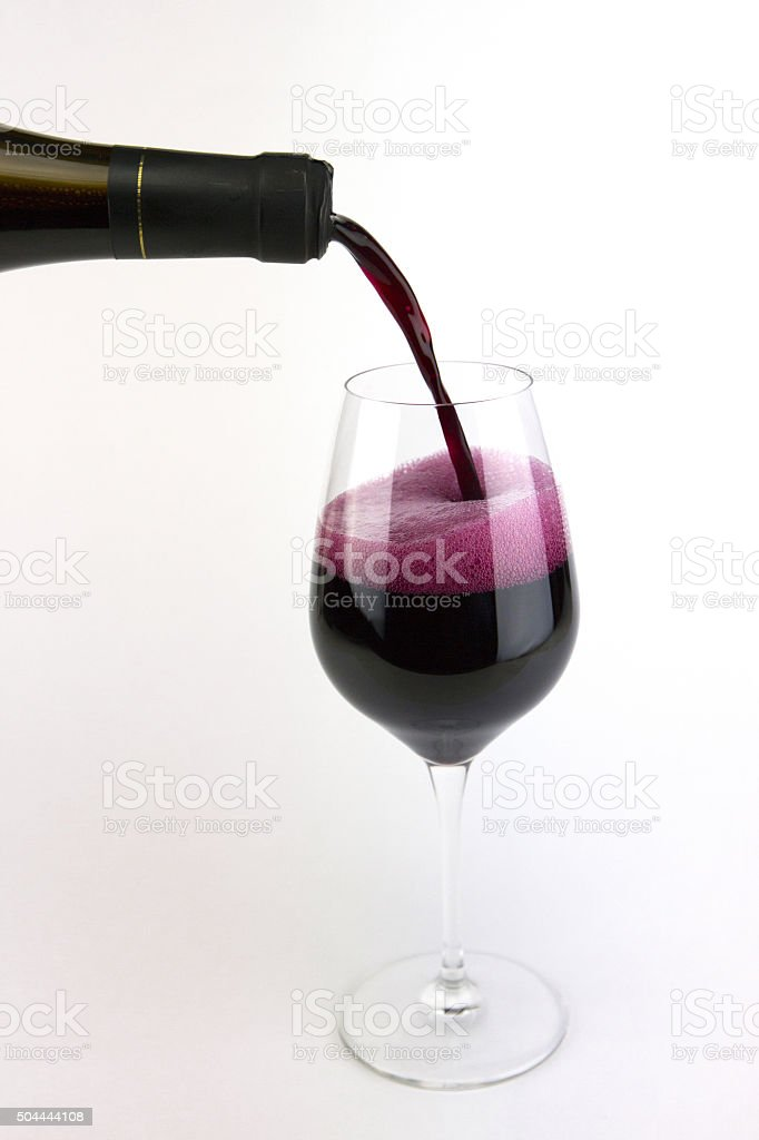 Glass of sparkling red wine on a white background stock photo