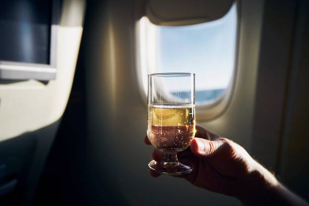 Glass of sparkling wine during flight stock photo