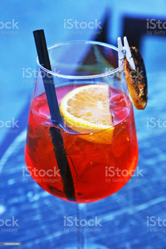 glass of aperol spritz cocktail - champagne with fresh orange juice stock photo