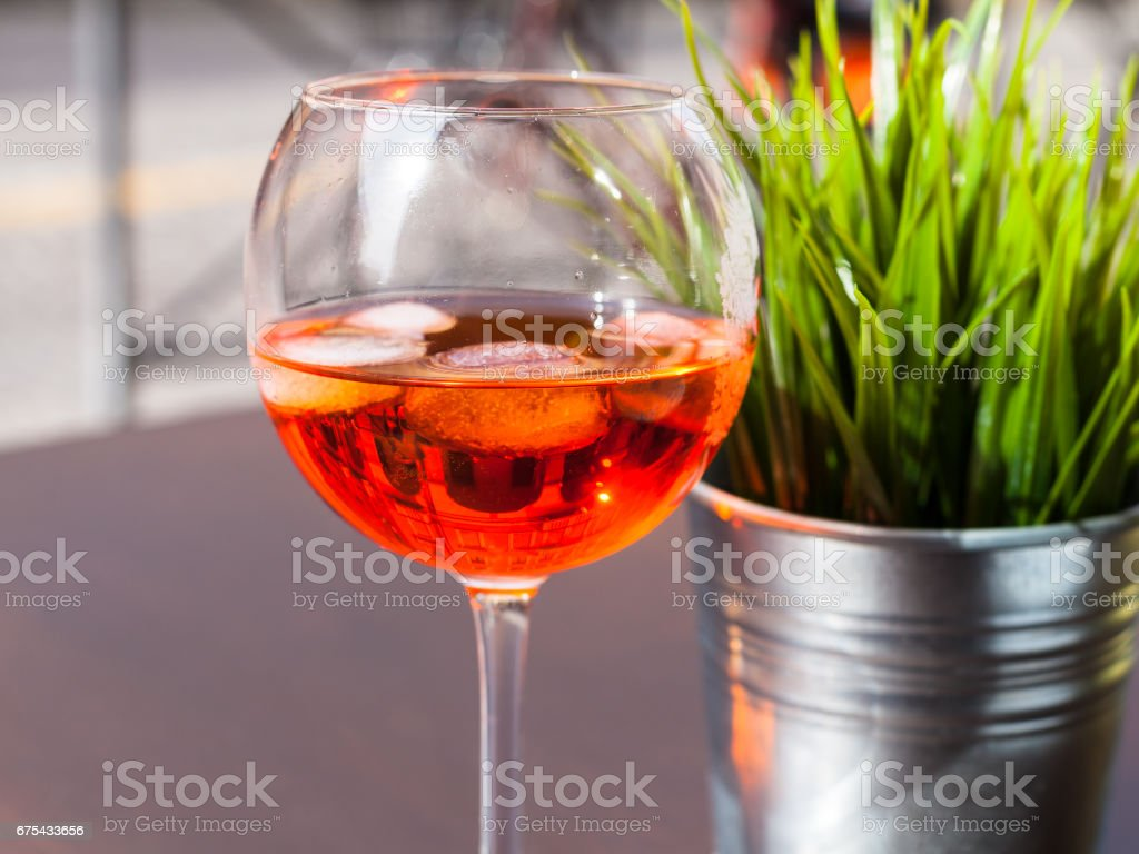 glass of Spritz drink with ice on table royalty-free stock photo