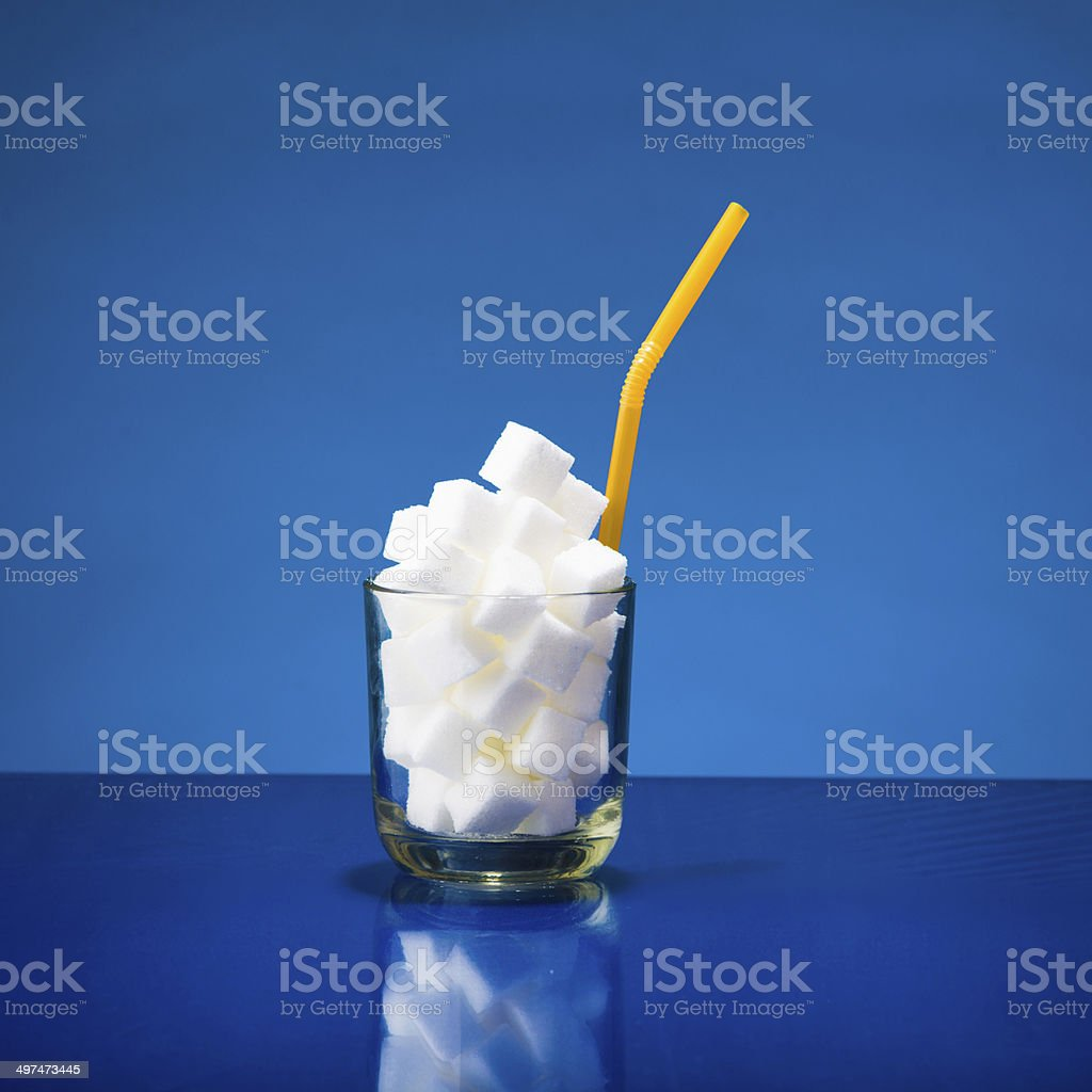 Glass of sugar stock photo
