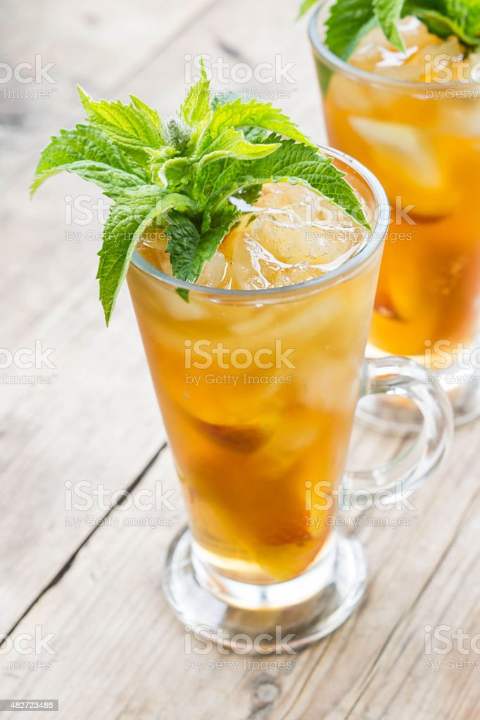 Glass of sweet peach iced tea stock photo