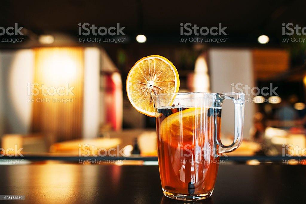 Glass of tasty citrus tea on restaurant table stock photo