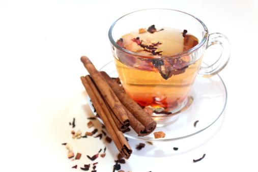 istock Glass of tea besides cinnamon and rosehip 479693597