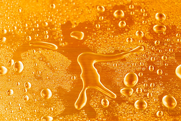 Glass of the fresh cold beer with bubbles and froth