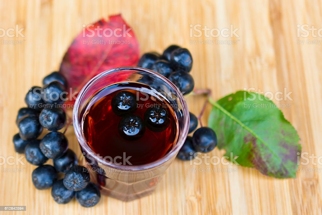 Glass of tincture of chokeberry. stock photo