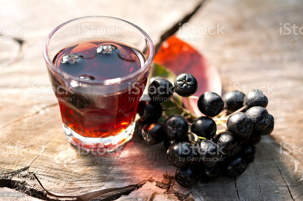 Glass of tincture of chokeberry. – zdjęcie