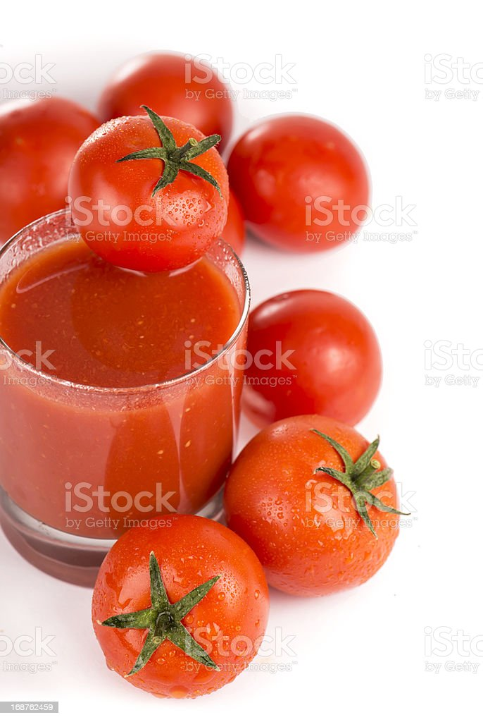 glass of tomato juice and tomatoes royalty-free stock photo
