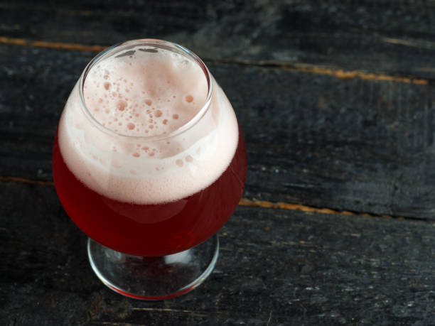 A glass of unfiltered cherry beer A glass of unfiltered cherry beer ale stock pictures, royalty-free photos & images