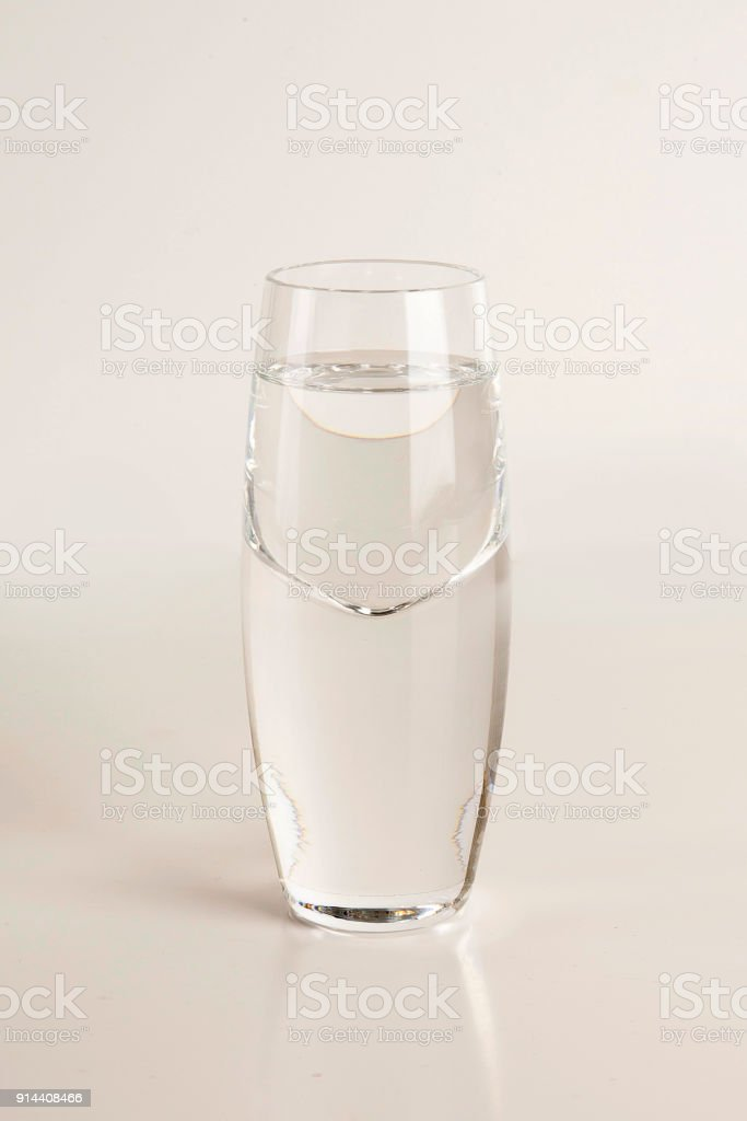 Glass of vodka on light gray background royalty-free stock photo