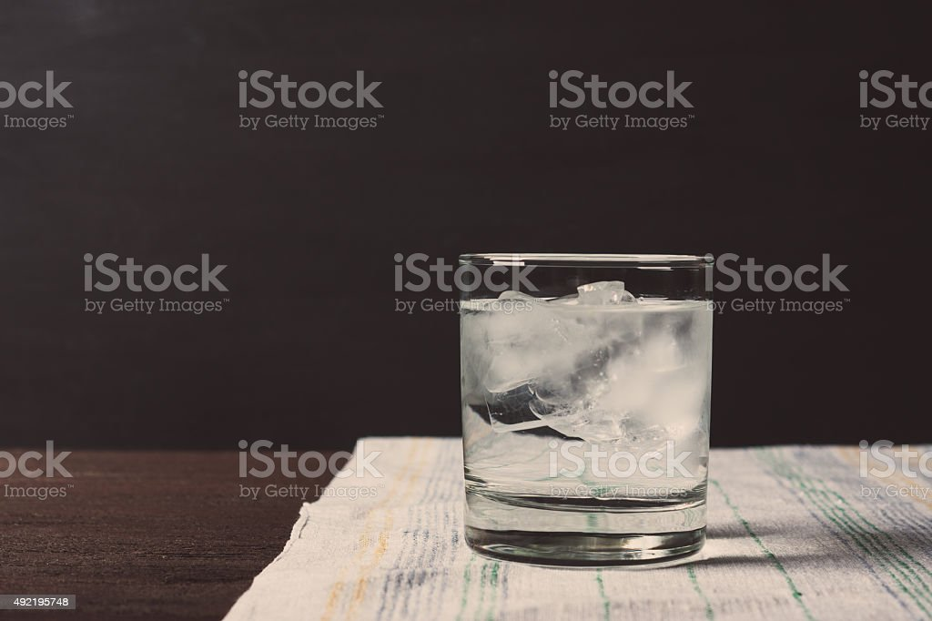 Glass of vodka on the rocks stock photo