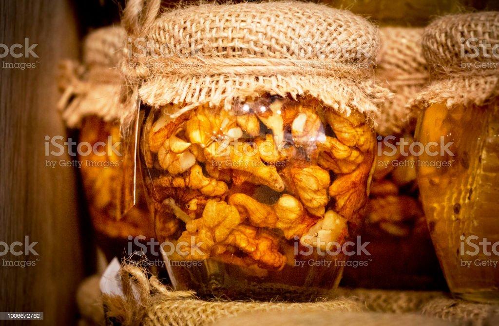 Glass of walnut oil stock photo