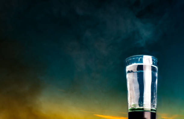 A glass of water against the sky stock photo