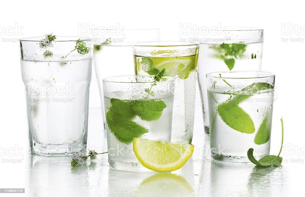 Glass of water and fresh herbs royalty-free stock photo