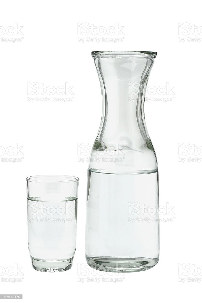 Glass of water and pitcher royalty-free stock photo
