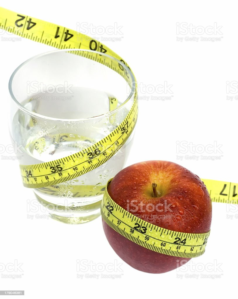 Glass of Water and Red Apple with measuring tape royalty-free stock photo