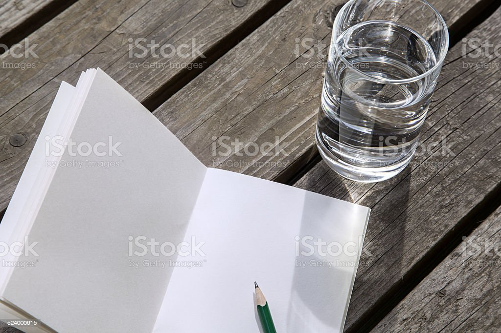 glass of water and writing in a emty book stock photo