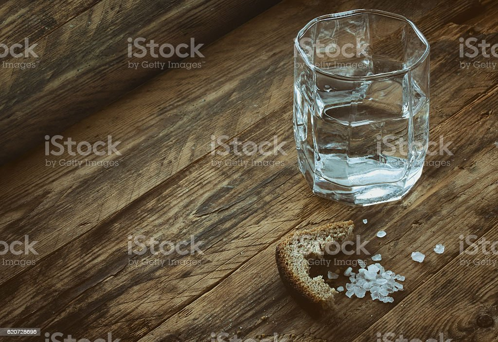 glass of water, crust of black bread, salt stock photo