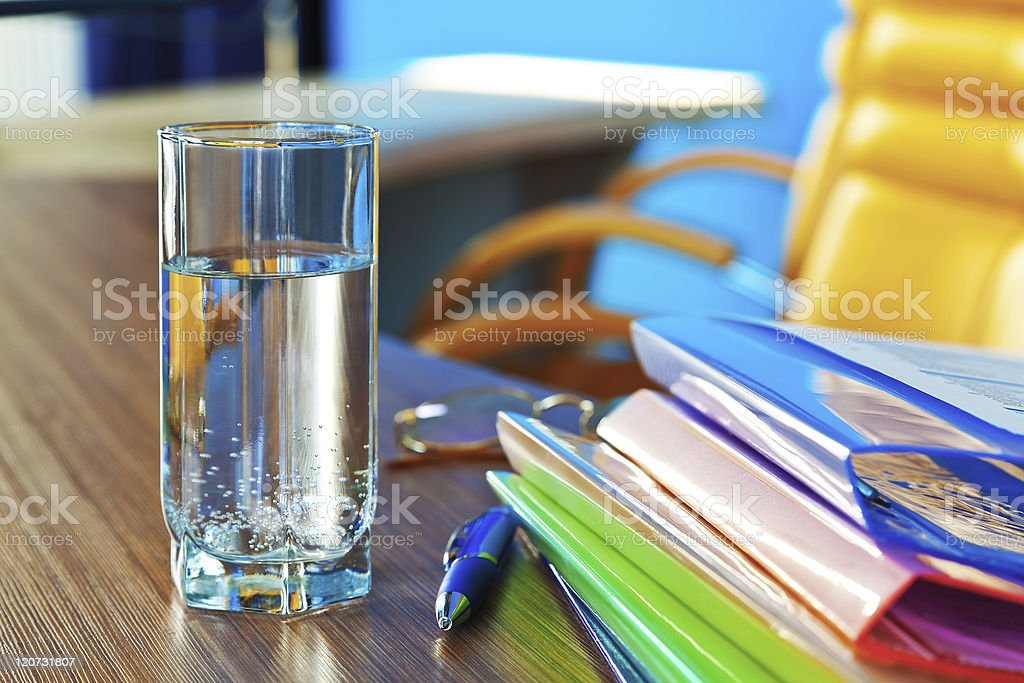 Glass of water in office stock photo