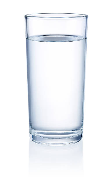 glass of water isolated on a white background - glass stock photos and pictures