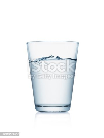 Glass of water isolated on white background with wave surface level